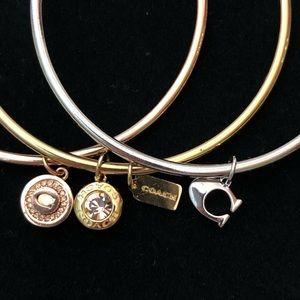 Coach- set of 3 bangle bracelets with Coach charms